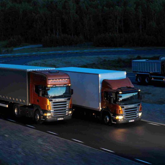 http://transborder-logistics.com/wp-content/uploads/2015/09/Three-orange-Scania-trucks-540x540.jpg