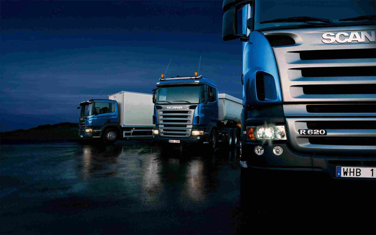 http://transborder-logistics.com/wp-content/uploads/2015/09/Three-trucks-on-blue-background-1200x750.jpg